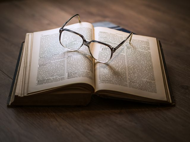 glasses and a book